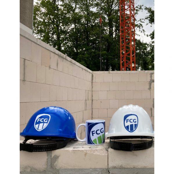 """Beim Kauf einer """"Jubiläums-Tasse"""" (25. Tasse, 50. Tasse, 75. Tasse usw.) gibt es einen """"FCG Bauhlem"""" in blau, weiß oder grün gratis."""